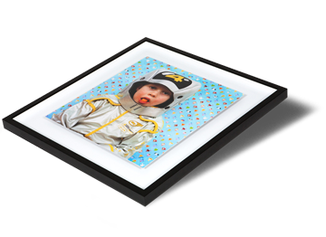 Floating box frames are a stylish take on the box frame, with your print mounted inside the box, rather than fitted edge to edge. Your print is mounted to 2mm aluminium or Dibond® substrate to create a sleek borderless surround for your print. There is a gap between the work and the moulding creating  a 'floating' effect. Framing options available in<span class=